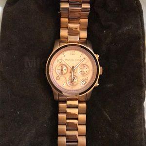 Michael kora rose gold watch